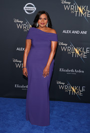Mindy Kaling oozed elegance wearing this asymmetrical purple off-the-shoulder gown by Greta Constantine at the premiere of 'A Wrinkle in Time.'