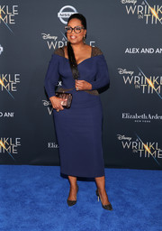 Oprah Winfrey cut a curvy silhouette in a form-fitting navy midi dress by Atelier Versace at the premiere of 'A Wrinkle in Time.'
