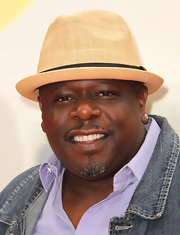Cedric the Entertainer exuded a summery vibe with his straw fedora.