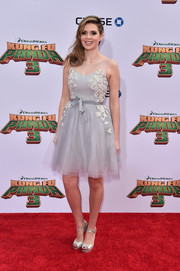 Carly Steel complemented her frock with a pair of silver ankle-strap peep-toes.