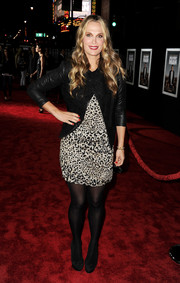 Molly Sims layered a black leather jacket over a leopard-print dress for an edgy-chic finish at the 'Delivery Man' premiere.