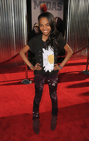 A hip China Anne McClain posed at the 'Real Steel' premiere wearing a pair of printed skinny pants teamed with a black tee and cardigan.