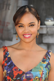 Sharon Leal brightened her smile with a lovely peony pink shade of lipstick and the premiere of 'Puss in Boots.'