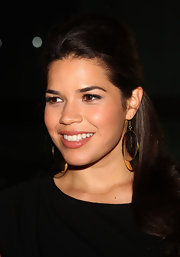 America Ferrera paired her gold hoop earrings with a half up half down 'do.