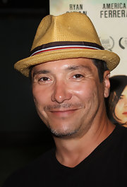 Benito showed off his casual cool style in a straw fedora hat.