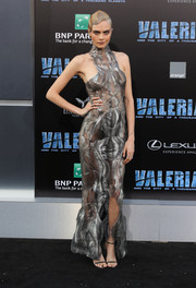 Cara Delevingne kept the shine going with a pair of silver Jimmy Choo sandals.