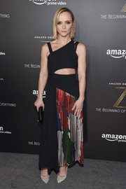 Christina Ricci looked uber trendy at the premiere of 'Z: The Beginning of Everything' in a Boss dress featuring an asymmetrical silhouette, a waist cutout, and a printed panel on the skirt.