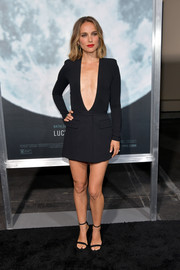 Natalie Portman looked daring in a black Givenchy bodysuit with a navel-grazing neckline at the premiere of 'Lucy in the Sky.'