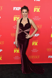 Penelope Cruz worked her figure in a burgundy Stella McCartney halter gown with lace inserts and a fishtail hem at the premiere of 'The Assassination of Gianni Versace: American Crime Story.'