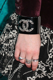Kaitlyn Dever accessorized with an eye-catching Chanel cuff at the 'Justified' series finale premiere.