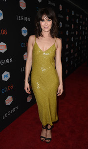 Katie Aselton went for some sexy shimmer in an olive-green sequin slip dress by Diane von Furstenberg at the premiere of 'Legion.'