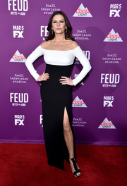 Catherine Zeta-Jones flaunted her ageless figure in a form-fitting Rhea Costa gown with a high slit and illusion shoulder straps at the premiere of 'Feud: Bette and Joan.'