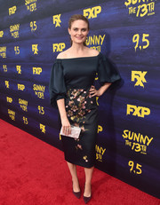 A pearlescent box clutch by Edie Parker rounded out Emily Deschanel's look.