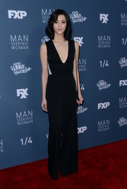 Katie Findlay worked a deep-V black jumpsuit at the premiere of 'Man Seeking Woman' season 3.