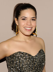 "Actress America Ferrera came out to the premiere of ""Our Family Wedding"" in a super-sleek ponytail and large gold hoop earrings."