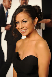 "Actress Anjelah Johnson sported a decadent bun to the premiere of ""Our Family Wedding"". She left out some face framing bangs for added interest."