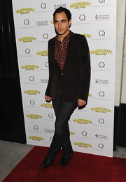 Zac paired his printed button down shirt with a chocolate brown blazer.