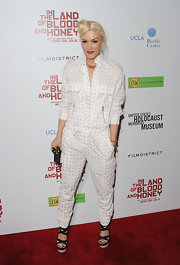 Gwen Stefani showed off her unique rocker aesthetic in a white utility jumpsuit at the premiere of 'In the Land of Blood and Honey.'