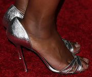Angela Bassett paired these silver heels with her yellow dress for a cool and sophisticated look.