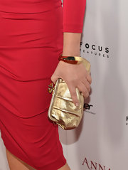 Marcia Gay Harden combined luxe colors as she styled her red dress with a gold snap-closure purse at the 'Anna Karenina' premiere.