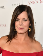 Marcia Gay Harden styled her look with hammered dangle earrings.