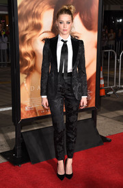 Amber Heard worked an androgynous vibe in a black floral pantsuit by Dolce & Gabbana during the premiere of 'The Danish Girl.'