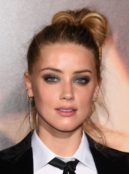 Amber Heard played up her eyes with lots of sparkly gray shadow.
