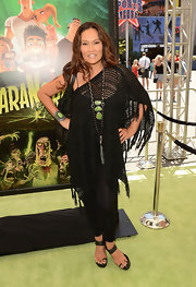 Tia Carrere matched her statement necklace with an equally striking gemstone bracelet.