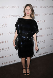 Sofia Coppola paired a sparkling shift dress with dainty black ankle strap heels embellished with sequins. Her signature carefree bob completes her premiere look.