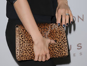 Mena Suvari added a little edge to her look with a navy blue polish.