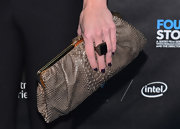 "AnnaLynne McCord stashed her party essentials in a snakeskin frame clutch at the premiere of ""Four Stories"" in Westwood, California."