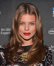 AnnaLynne's bright crimson lips did at the talking at the 'Four Stories' after-party.