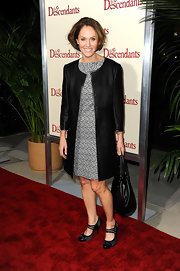 Amy Brenneman paired her print shift dress with a  sophisticated black collarless coat with cropped sleeves.