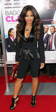 Christina Milian rocked a pair of black bike shorts with a stylish jacket at the premiere of 'Baggage Claim.'