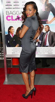 Jennia Fredrique brought some sparkle to the 'Baggage Claim' red carpet with a pair of bedazzled gray platform pumps.