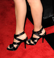 Marisa wore elegant strappy satin sandals with a modern LBD.