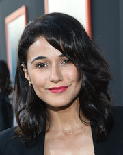 Emmanuelle Chriqui attended the premiere of 'Me and Earl and the Dying Girl' wearing tousled waves and side-swept bangs.