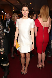 For a pop of color to her neutral outfit, Jessica Biel accessorized with a bright yellow Fendi clutch.