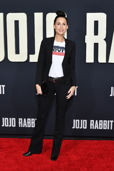 Minnie Driver was casual in black bootcut jeans and a logo tee at the premiere of 'Jojo Rabbit.'