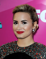 Demi Lovato added even more sparkle to her shimmering dress with these flashy floral gemstone studs.