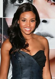 Meagan Tandy looked radiant on the red carpet. The actress paired her strapless dress with flowing long curls.