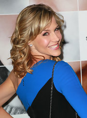Julie Benz was all smiles as she showed off her honey-highlighted curls at the premiere of 'Frankie and Alice'.