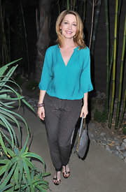 Sharon Lawrence sported a teal blouse, which she paired with checked pants, at the premiere of 'Some Girl(s).'