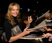 Rebecca Romijn attended the 'Ass Backwards' premiere carrying an ultra-chic metallic silver clutch.