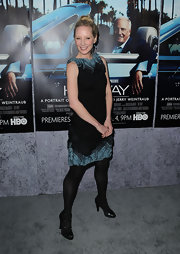 Anne Heche donned black patent triple strap pumps over a pair of matching opaque tights to the premiere of 'His Way.'