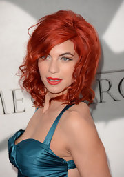 Natalia Tena showed off her fiery red locks with this shoulder-length curly 'do.