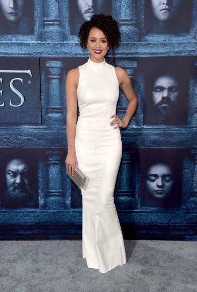 Nathalie Emmanuel styled her dress with a metallic silver clutch by Jimmy Choo.
