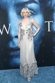 Gwendoline Christie oozed sophistication in a plunging nude gown with silver beading at the premiere of 'Game of Thrones' season 7.