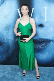 Maisie Williams flashed some skin in a green spaghetti-strap halter dress by Milly at the premiere of 'Game of Thrones' season 7.