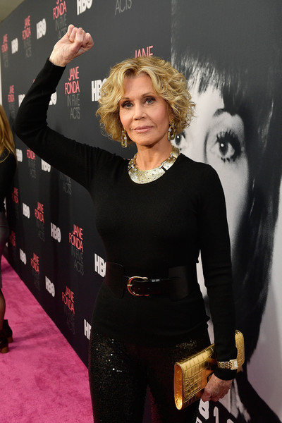 Jane Fonda arrived for the premiere of 'Jane Fonda in Five Acts' carrying a chic metallic croc-embossed clutch.